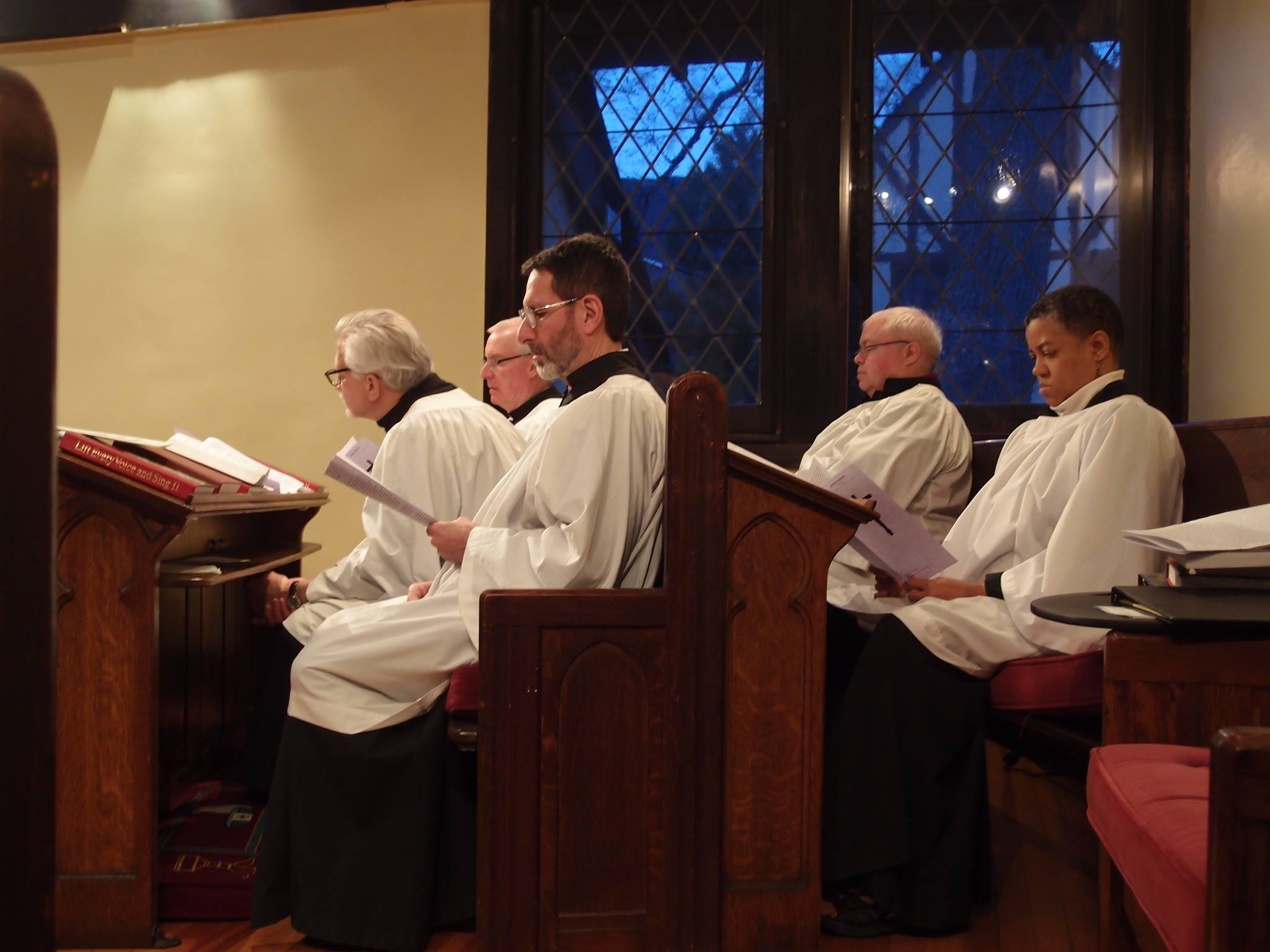 Choir members listen to reading of the Passion